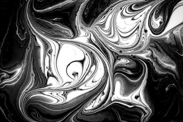 Schwarzweiss-abstrakter flüssiger marmorhintergrund.