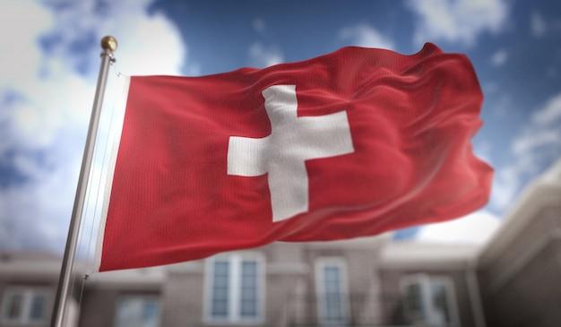 Schweiz flagge 3d rendering auf blauem himmel gebäude hintergrund