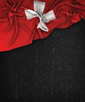 Schweiz-flagge weinlese auf einer grunge-schwarzen tafel mit raum für text