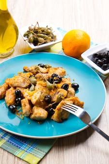 Schwertfischeintopf mit kapern und oliven