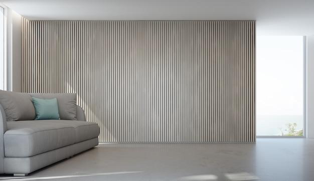 Seeansichtwohnzimmer des luxussommerstrandhauses mit glasfenster und konkretem boden.