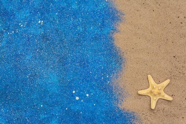 Seestern, sand und glitzer