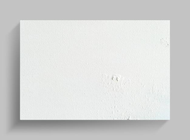 Segeltuchrahmen auf grauem wandhintergrund mit weichem schatten.