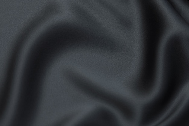 Seiden- oder baumwollgewebe. dunkelgraue oder schwarze farbe. textur, hintergrund, muster.