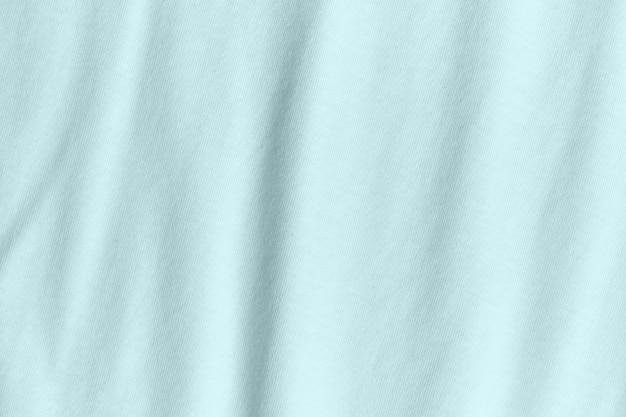Seidenstoff in türkisfarbener farbe als hintergrund und textur