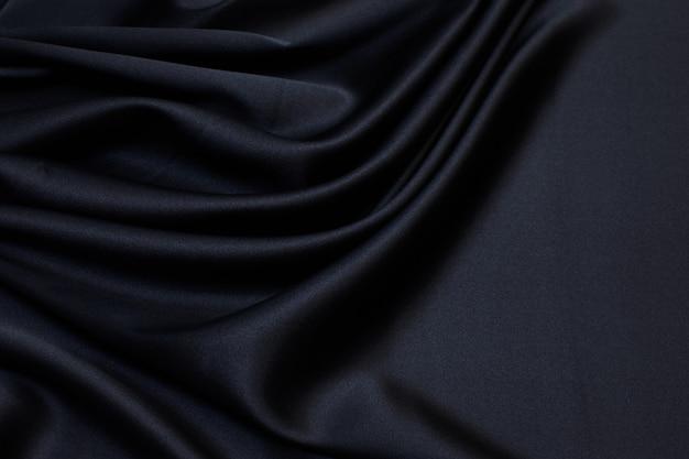Seidenstoff, satin. schwarze farbe. textur,