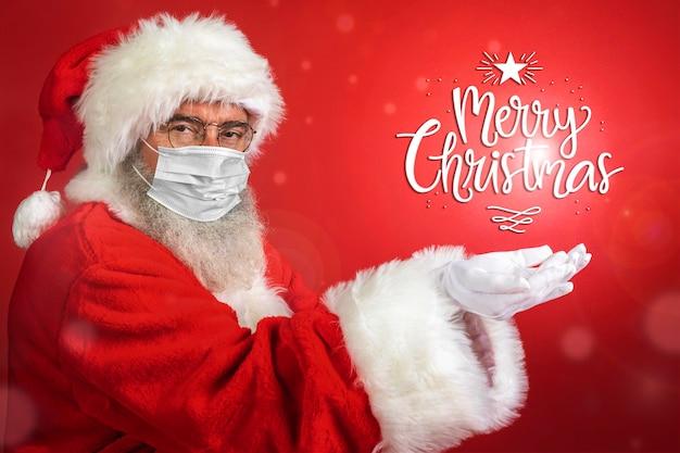 Seitenansicht des mannes im weihnachtsmannkostüm, das medizinische maske trägt