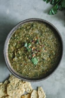 Selbst gemachte grüne tomatillo salsalebensmittelphotographie-rezeptidee