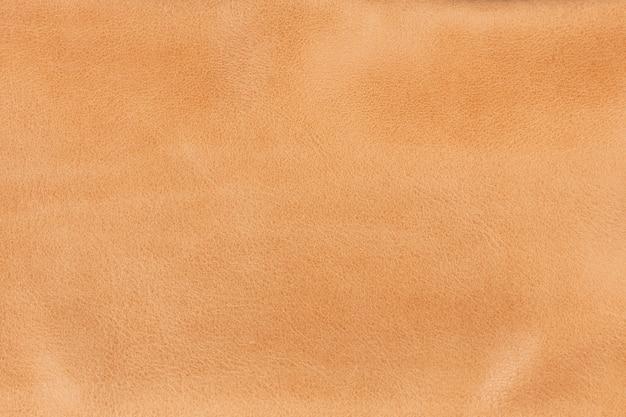 Senf strukturierter glatter lederoberflächenhintergrund, kleine körnung