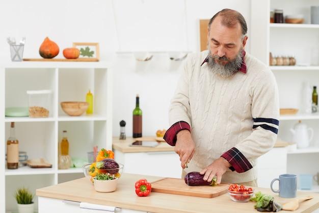 Senior man cooking