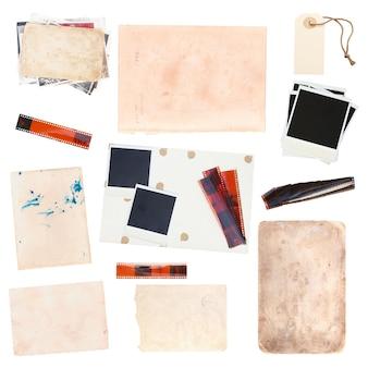 Set aus verschiedenen alten papierbögen und vintage-fotos auf weißem hintergrund