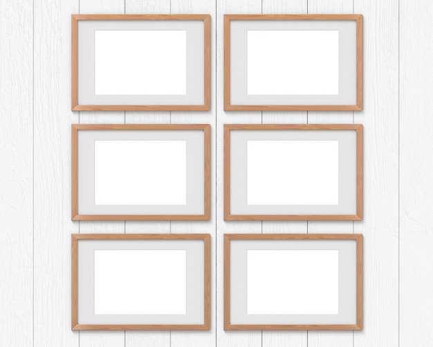 Set von 6 horizontalen holzrahmen mit einem rand an der wand hängen.