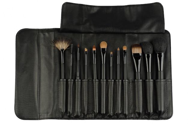 Set von schwarzen make-up pinsel isoliert auf weiß