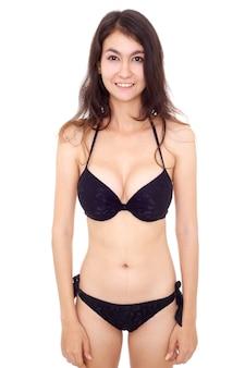 Sexy schöne junge frau im bikini isoliert auf weißem hintergrund