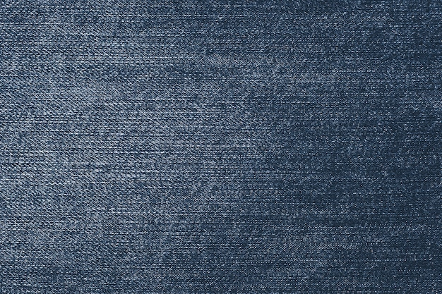 Shabby dark denim. blue jeans hintergrund. stoffmuster.