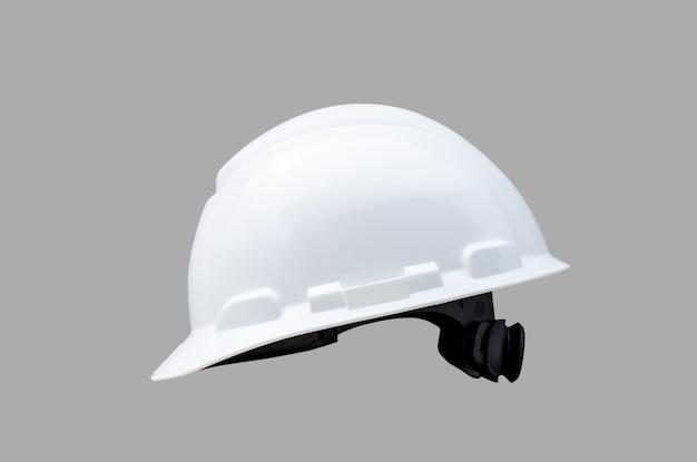 Sicherheits-hardhat lokalisiert auf grauem hintergrund