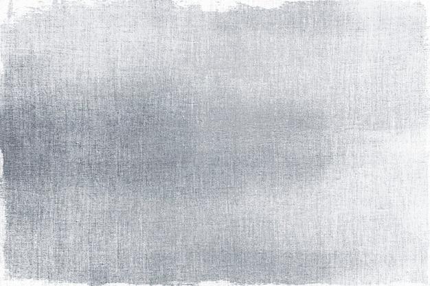 Silber auf einem strukturierten stoffhintergrund gemalt