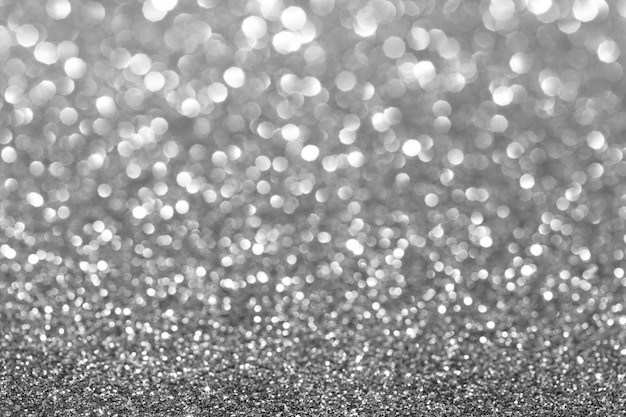 Silber glitter hintergrund. funkelnde textur.