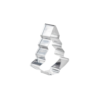 Silberfarbener edelstahl-ausstecher in form eines stehenden tannenbaums