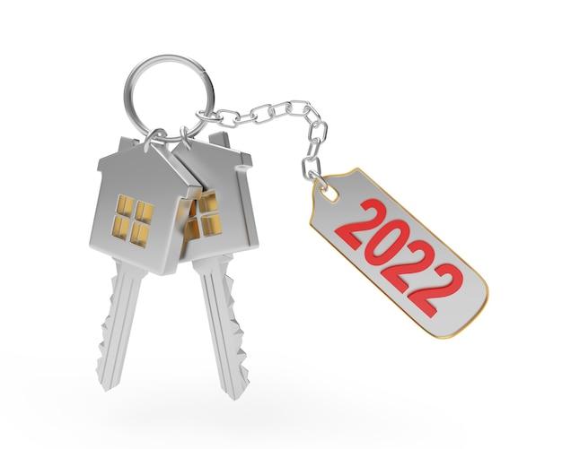 Silberne hausschlüssel mit schlüsselanhänger und neujahrszahlen