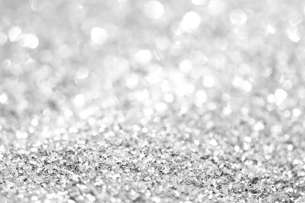Silberner hintergrund von defocused abstrakten lichtern. goldene bokeh lichter.