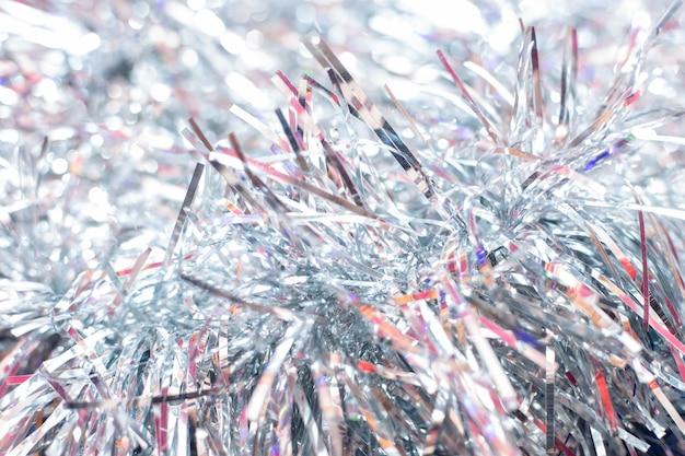 Silberner lametta-weihnachtshintergrund