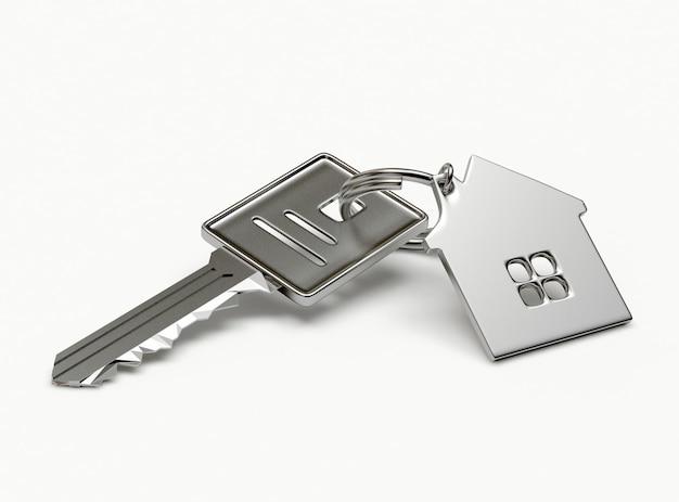 Silberner schlüssel mit hausschlüsselanhänger