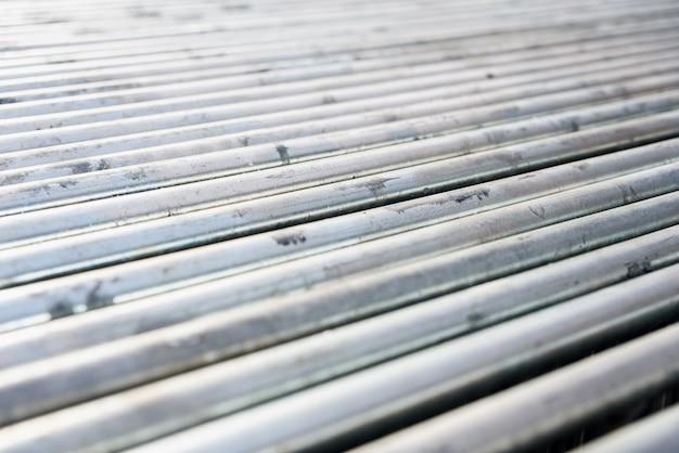 Silberner stahlmetallstangenabschluß oben, mit unfocused hintergrund