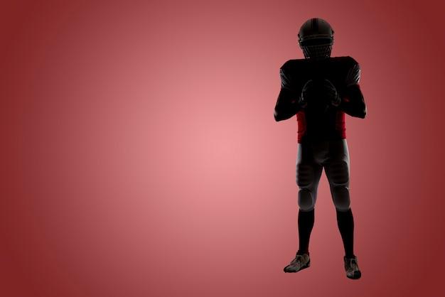Silhouette eines fußballspielers mit einer roten uniform an einer roten wand