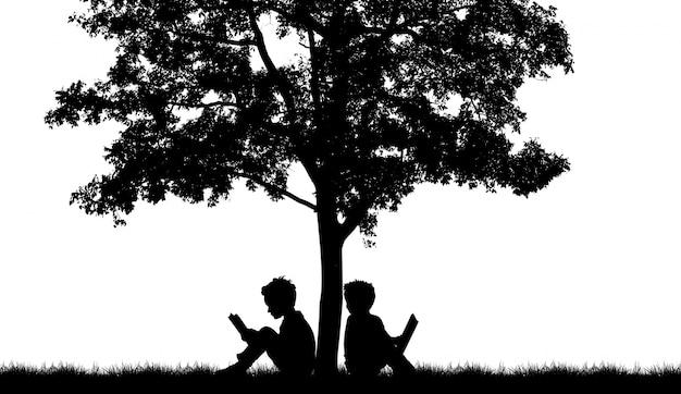 Silhouette von zwei personen auf einem baum