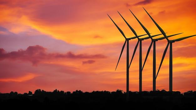 Silhouetten windkraftanlagen bei sonnenuntergang, alternative erneuerbare energie