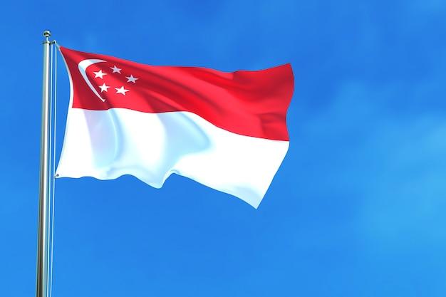 Singapur-flagge auf dem hintergrund des blauen himmels