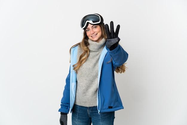 Skifahrermädchen mit snowboardbrille lokalisiert auf weißer wand glücklich und zählt drei mit den fingern
