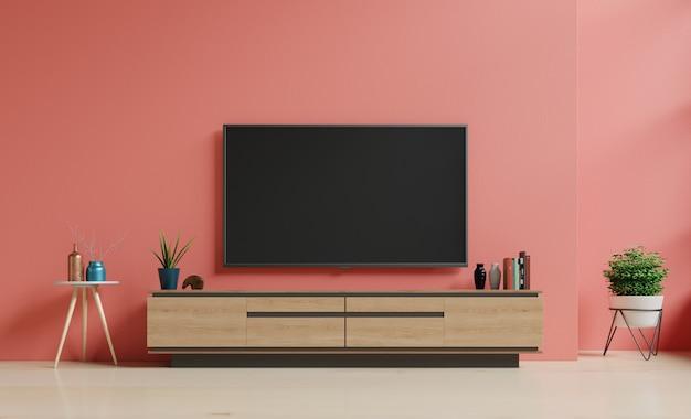 Smart tv an der dunkelblauen wand im wohnzimmer