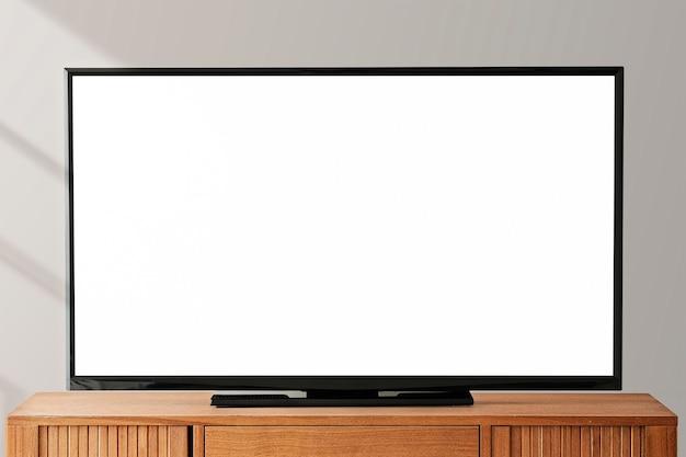 Smart-tv-bildschirm mit kopienraum auf einem holztisch