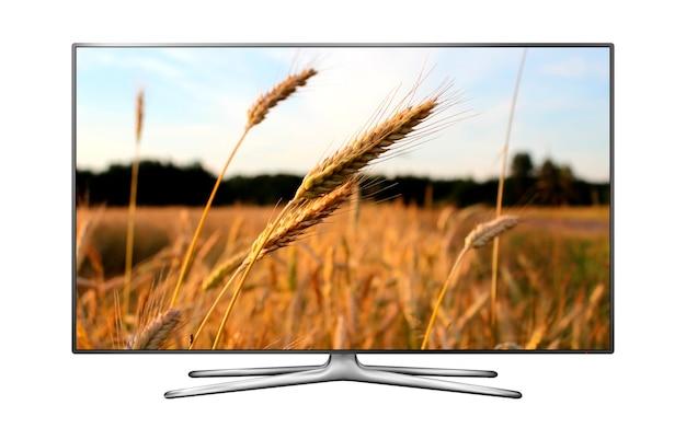 Smart tv lokalisiert auf weiß mit weizenfeld auf dem bildschirm