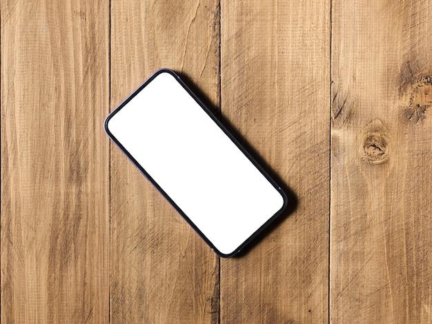 Smartphone auf dem tisch mit isoliertem mockup-hintergrund