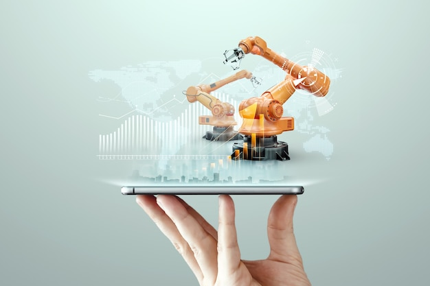 Smartphone in der hand eines mannes und roboterarme einer modernen anlage. iot technologiekonzept, smart factory. digitaler fertigungsbetrieb. industrie 4.0.
