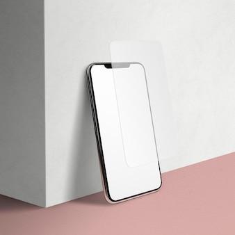 Smartphone mit kopienraumdesign auf dem boden