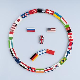 Smiley-gesicht von nationalflaggen auf dominosteinen konzept des friedens und des commonwealth of nations