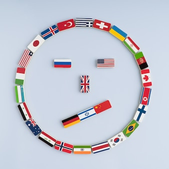 Smiley-gesicht von nationalflaggen auf dominosteinen konzept des friedens und des commonwealth