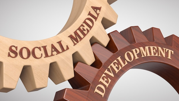 Social media-entwicklung auf zahnrad geschrieben