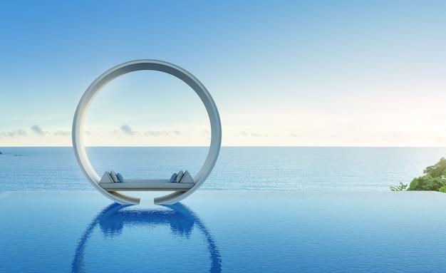 Sofa und swimmingpool im luxushotel mit meerblick.