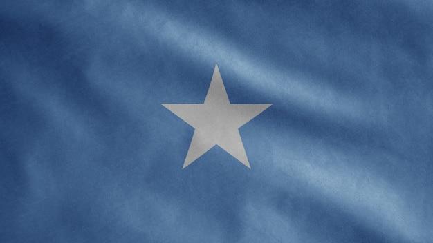Somalische flagge, die im wind weht. nahaufnahme der somalischen schablonenblasen, weiche und glatte seide. stoff stoff textur fähnrich hintergrund. verwenden sie es für das konzept des nationalfeiertags und der länderanlässe
