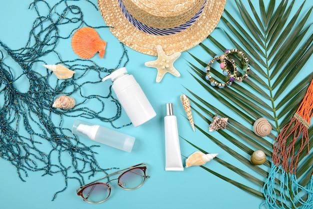 Sommer- und sonnencreme, kosmetika für die hautpflege und damenaccessoires.