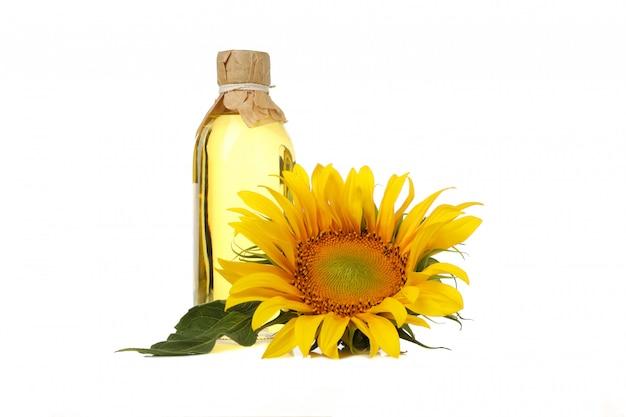 Sonnenblume und öl auf weiß Premium Fotos