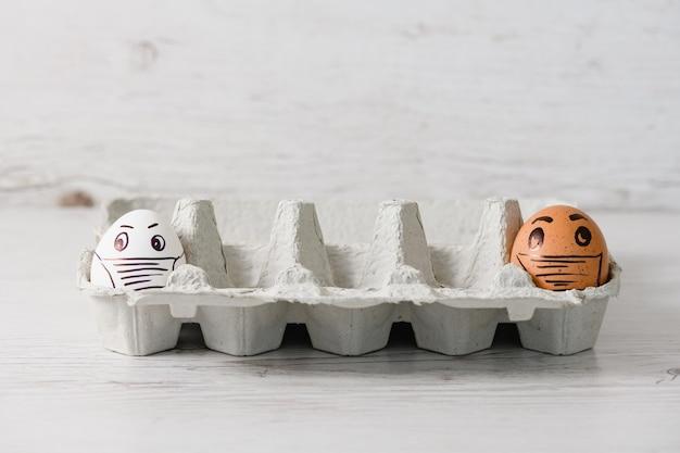 Soziale distanz mit ostereiern in masken