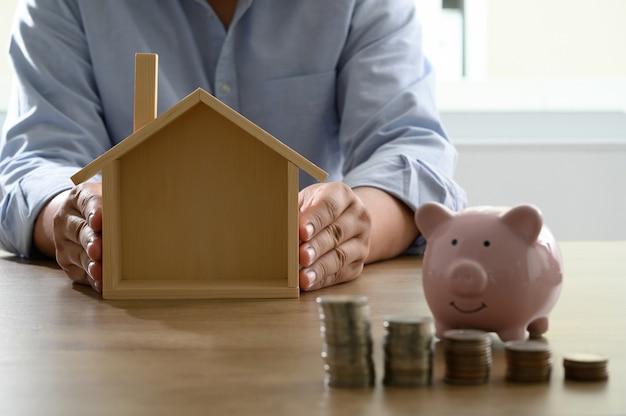 Sparen sie geld für das einsparen von eigenheimkosten, kontobuch oder finanzbericht