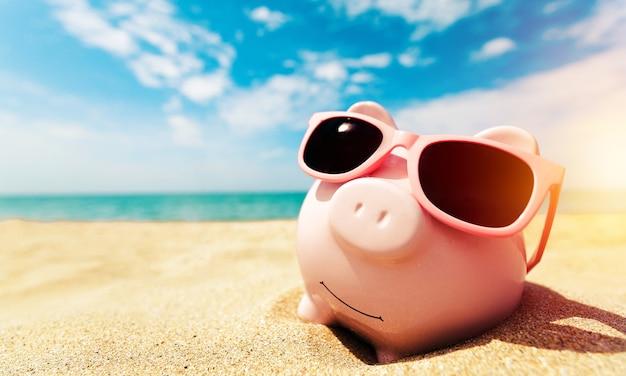 Sparschwein mit sonnenbrille beim entspannen