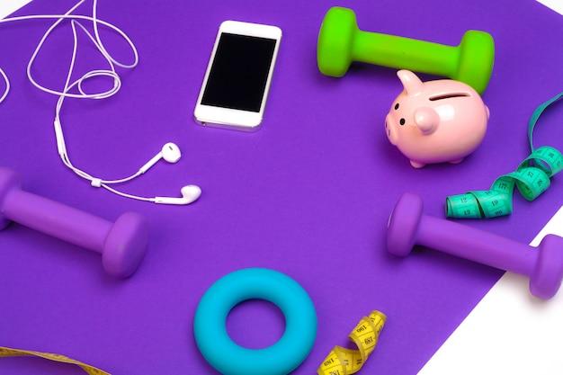 Sparschwein mit sportgeräten